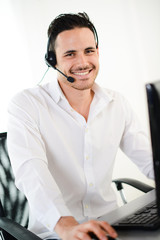 handsome young male telephone customer support hotline service