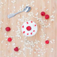 Dessert of raspberries, oats, cream