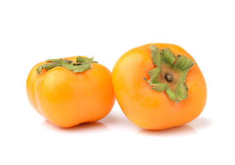 ripe persimmons isolated on white background