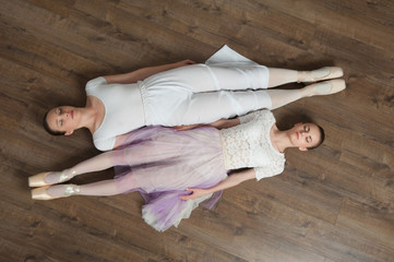Two beautiful ballet dancers posing