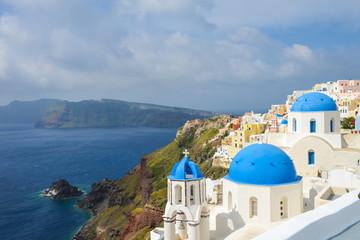 Classic Santorini scene with famous blue dome churches