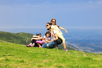 Family on the mountain in summer