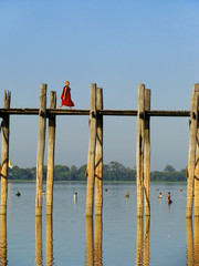 Buddhist monk walking on U Bein bridge, Amarapura, Myanmar