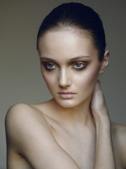 model in studio with nude make up
