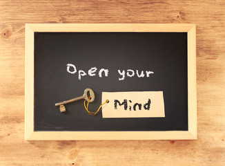 top view of blackboard with the phrase open your mind written on