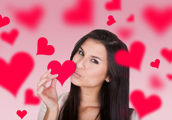 Woman Holding While Kissing Heart Shape Paper