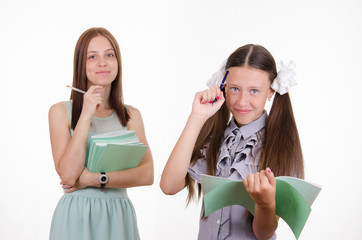 Portrait of a teacher and student with notebooks