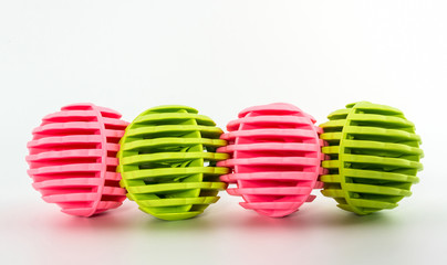 Row of Pink and green washing ball, plastic balls