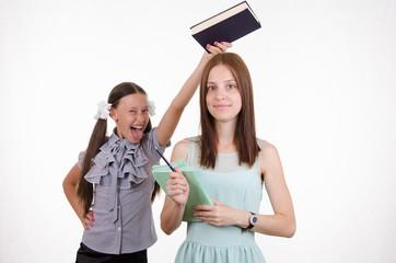 Trainee teacher has on the head