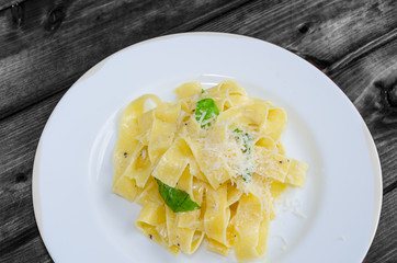 Fresh pappadelle pasta with lemon, basil and creame