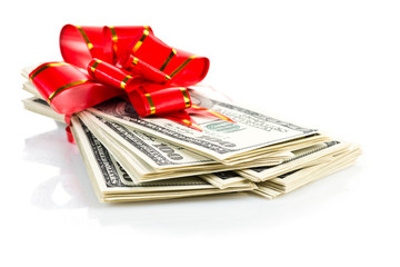 Money gift (big stack of dollars with red bow isolated on white