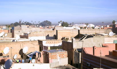 Marrakesh rooftops on a background Atlas Mountains