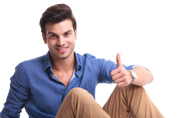 positive smiling man with ok thumbs up hand sign