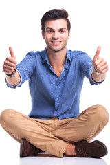 seated casual man making the ok thumbs up gesture