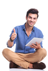 casual man with tablet pad computer making the ok sign