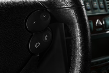 Buttons on steering wheel. Car interior.