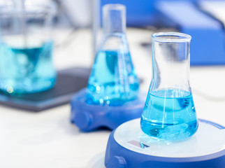 flasks with blue liquid in the chemical laboratory