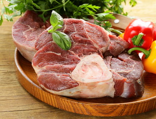 fresh raw meat ossobuco on a wooden board
