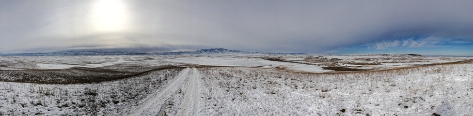 Winter valley panorama with road