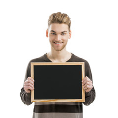 Man holding a chalkboard