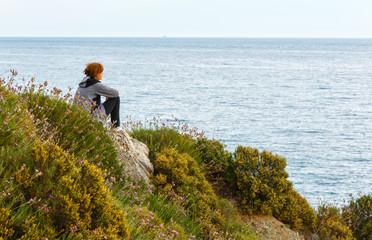 Woman on Potistika beach. Morning view (Greece)