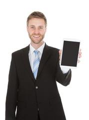 Smiling Businessman Displaying Digital Tablet