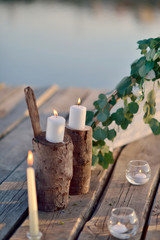 on a wooden bridge in the sun romantic arrangement of candles, g