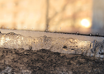 Frost and sun on glass
