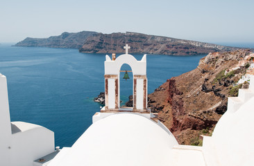 The church with the bell tower on Santorini, Oia. Greece.