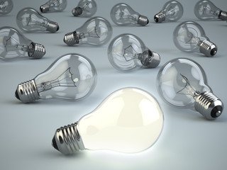 Idea concept. Light bulbs on grey background.