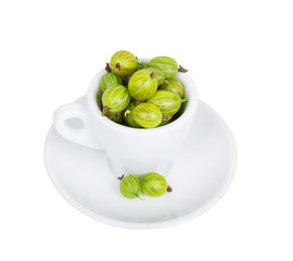 Gooseberries in white cup and saucer