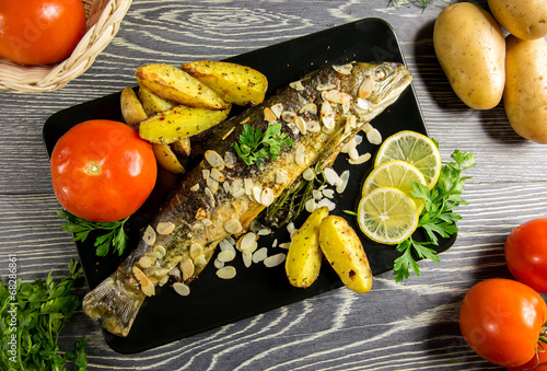 Fried trout with almonds - 68286861