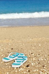 Stripped flip flops on the beach