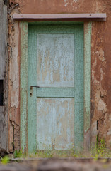 old wooden door with weathered paint