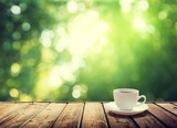 Fototapety cup coffee and sunny trees background