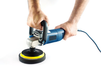Man holding car polishing machine isolated