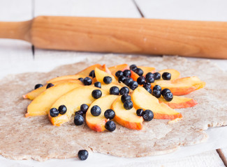 process of preparing biscuits with peach and blueberry