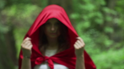 Mysterious beautiful woman, red riding hood, super slow motion