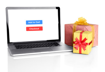 Concept for Internet shopping: laptop and gifts isolated