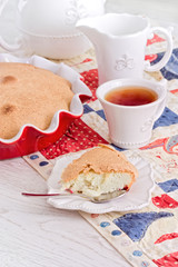 tea time with apple Pie and berry on red-blue napkin