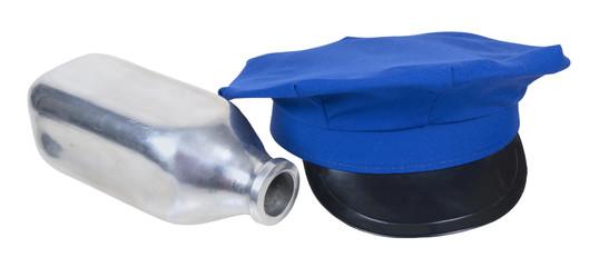 Milkman delivery hat and fallen silver milk bottle