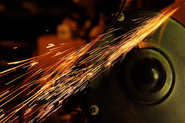 Glowing Flow of Sparks from Grinder