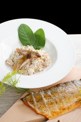 Brown rice risotto with smoked fish and cream sauce