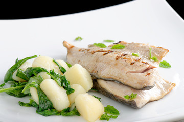 Grilled white fish fillets with potato and spinach