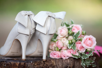 wedding shoes with bouquet