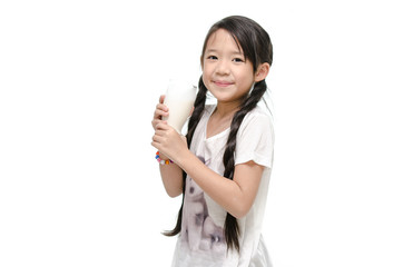 Little asian girl drinking milk