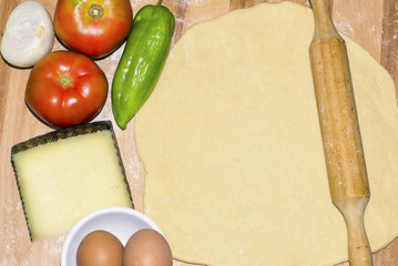 Dough raw pizza with vegetarian ingredients