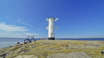 White old lighthouse in Swinoujscie, Poland (Time Lapse)