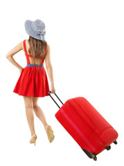 Woman pulling red suitcase vacation. Summer holiday travel.