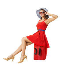 Woman sitting on vacation suitcase. Summer holiday travel.